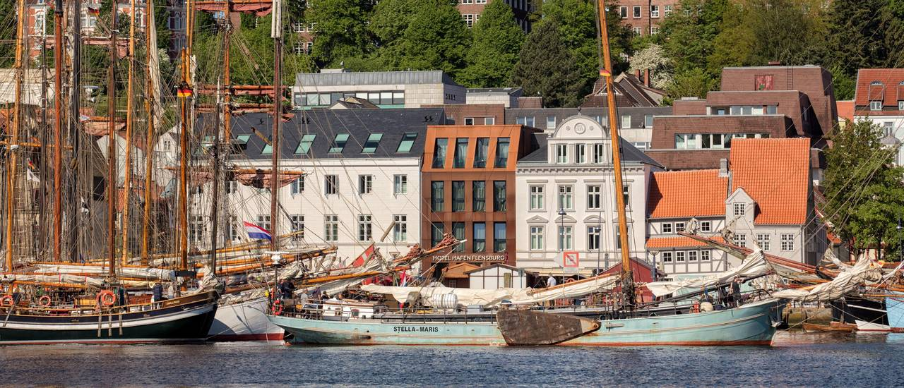 Hotel Hafen Flensburg, photograph during Rum regatta 2017with numerous sailing ships in front of the hotel